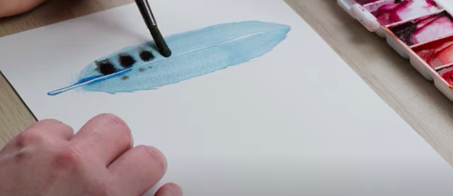 Adding patterns to feathers using watercolour