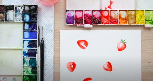 painting a pattern with berries